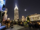 A spectacular view of the Empire State Building at night, from the Monarch rooftop lounge on West 35th Street.