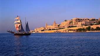 An old sail boat in the Marsamxett harbour at Valletta.